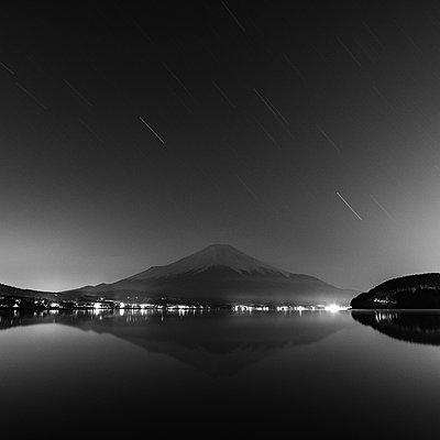 Night shot of Mount Fuji from lake Yamanaka, Yamanashi Prefecture, Japan - p1166m2201381 by Cavan Images