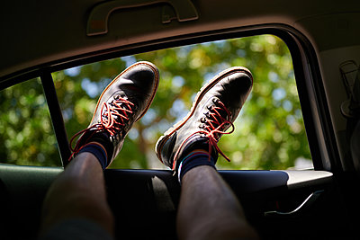 Relaxation, feet in open car window - p1640m2245862 by Holly & John