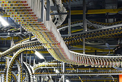 Conveyor belt with printed newspapers in a large printing company - p300m961809 by Sten Schunke