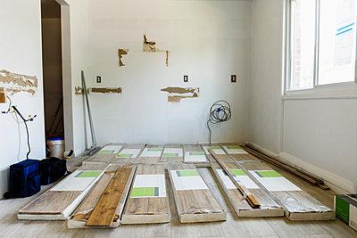 Packages of flooring on floor - p555m1504165 by Roberto Westbrook