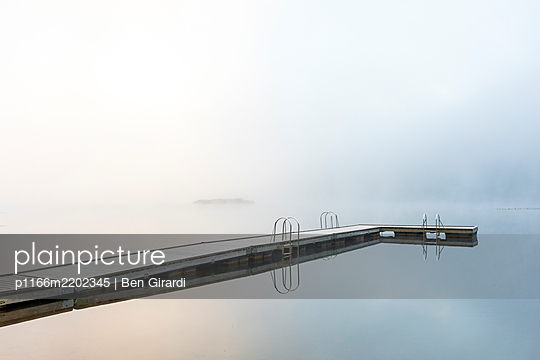 Jetty on shore of One Mile Lake at sunrise,Pemberton, British Columbia, Canada - p1166m2202345 by Ben Girardi