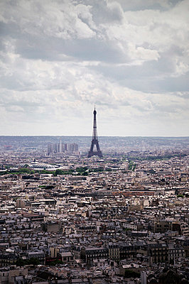 Eiffel Tower in distance looming over Paris - p1072m836374 by Neville Mountford-Hoare