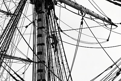 A sailor is climbing in the rigging of a tall ship. - p1072m1056695 by KuS