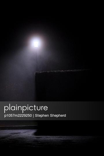 Street lamp in the fog - p1057m2229250 by Stephen Shepherd