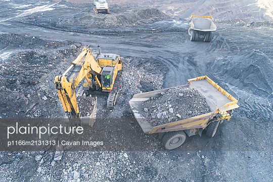 Excavator Loading Coal Truck from Aerial View - p1166m2131313 by Cavan Images