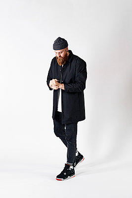 Man in casual clothes and knit cap - p1124m2229063 by Willing-Holtz