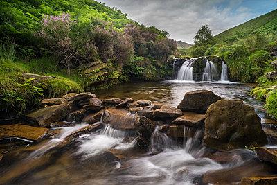 Water cascading over rocks on moorland habitat, Fairbrook, Peak District National Park, Derbyshire, England, United Kingdom, Europe - p871m1506613 by Robert Canis