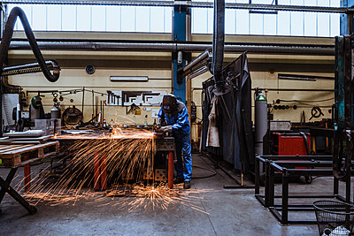 Welder welding metal in a factory - p300m2197610 by Daniel Ingold