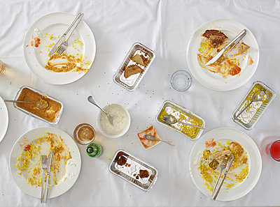Overhead view of dirty dishes on table - p429m769058f by Tim MacPherson