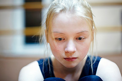 Caucasian girl looking down - p555m1412870 by Vladimir Serov
