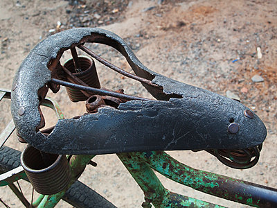 Worn-out bicycle seat; allepey kerala south india - p644m786032 by Chris Bradley