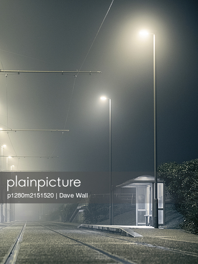 Tramlines in the fog at night - p1280m2151520 by Dave Wall
