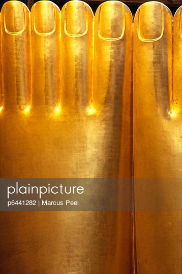 Feet of gold reclining Buddha - p6441282 by Marcus Peel