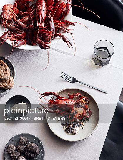 Meal of lobsters - p924m2135647 by BRETT STEVENS