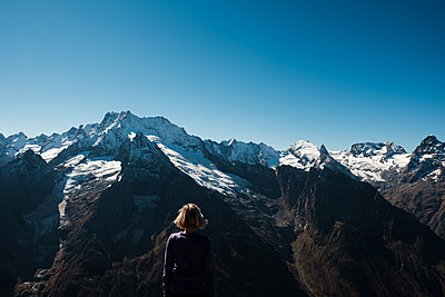 Woman is looking on Caucasus Mountains - p1363m2054112 by Valery Skurydin