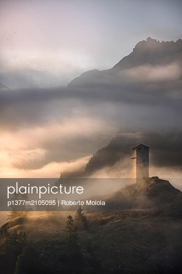 Switzerland, Graubünden, Grigioni, Grisons, Engadin, Alps, Ardez, Tower of Steinsberg Castle shrouded by mist, Ardez - p1377m2105095 by Roberto Moiola