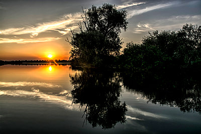 Reflections at sunset - p1072m1349007 by Grigore Roibu