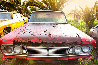 Front view of vintage car in scrap yard - p429m875759f by Zero Creatives