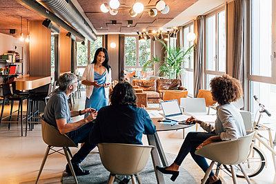 Italy, Business people having meeting in creative studio - p924m2300676 by Eugenio Marongiu