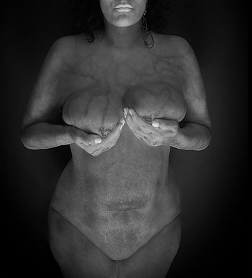 Woman palpating her breasts - p1508m2168820 by Mona Alikhah