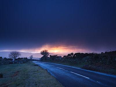 Moody winter sunrise in a hail shower at Bel Tor Corner, Dartmoor National Park, Ashburton, Devon, England, United Kingdom - p871m2075247 by Baxter Bradford