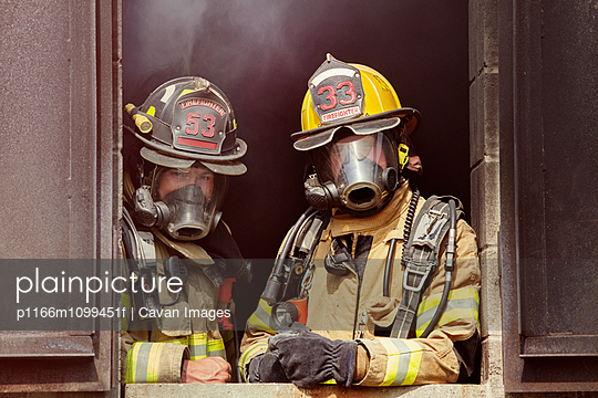 Portrait of firefighters in gas masks