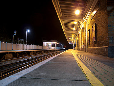 Empty station platform at night - p1072m829307 by Neville Mountford-Hoare