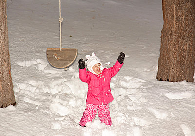 Girl playing in snow - p429m801763 by Susan Gary Photography