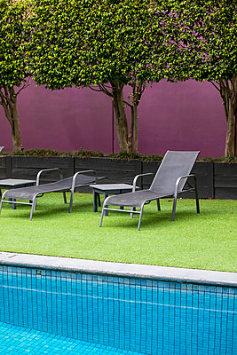 Deckchairs by the pool - p628m2184108 by Franco Cozzo