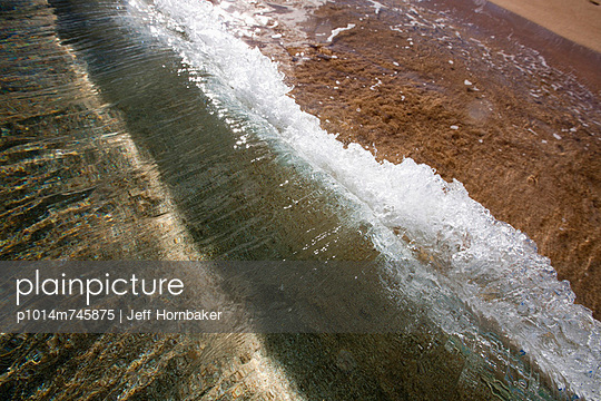 Waves Crashing Down On Shore  - p1014m745875 by Jeff Hornbaker