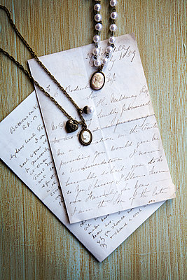 Cameo Necklaces on old Letters  - p1248m1538596 by miguel sobreira