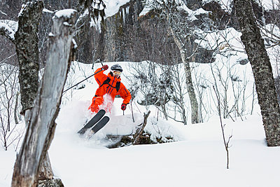 Telemark skiier pops a pillow in Are, Sweden. - p343m1093533f by Elias Kunosson