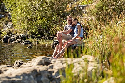 Couple relaxing on lake - p1355m1574062 by Tomasrodriguez