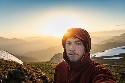 Hiker trekking French Alps, Parc naturel régional du Massif des Bauges, Chatelard-en-Bauges, Rhone-Alpes, France - p429m2036440 by Manuel Sulzer