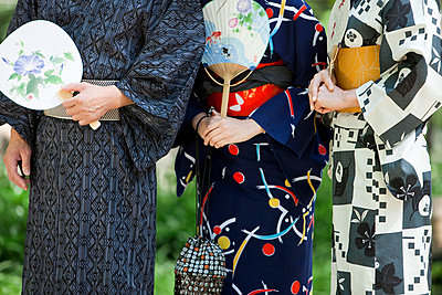 Midsection of family wearing a Yukata - p5148355f by a.collectionRF