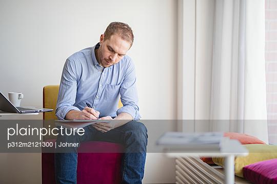 Man writing - p312m2121300 by Johner
