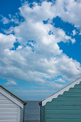 Beach huts looking out to sea - p1228m1466074 by Benjamin Harte