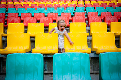Toddler girl in a stand, Friedrich-Ludwig-Jahn-Sportpark - p1093m2193615 by Sven Hagolani