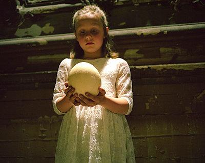 Girl with ostrich egg - p945m716040 by aurelia frey