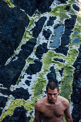 Man on Rocky Oregon Coastline - p1262m1125270 by Maryanne Gobble