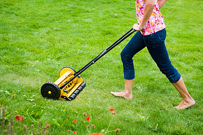 A woman using a lawn mower Sweden. - p31218096f by Plattform
