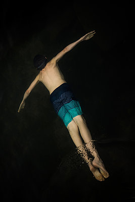 Boy Swimming with Arms Outreached - p1503m2031837 by Deb Schwedhelm