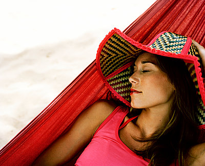 A Scandinavian woman resting in a hammock Thailand - p312m1076701f by Nicho Sodling