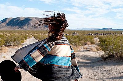 Woman walking in wind - p4620582 by BHarman