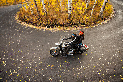 Caucasian couple riding motorcycle - p555m1464326 by Mike Kemp