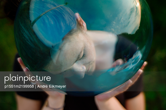 Woman with glass ball - p1551m2199958 by André Eikmeyer