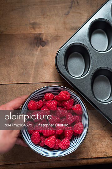Raspberries and baking pan - p947m2184671 by Cristopher Civitillo