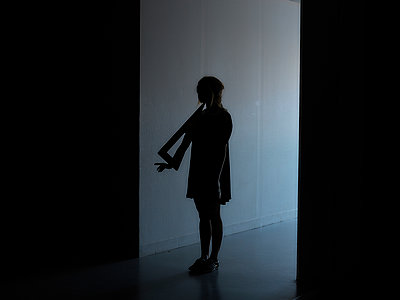Girl in dark corridor - p1413m1511813 by Pupa Neumann
