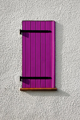 Window with a violet shutter - p1423m2128110 by JUAN MOYANO