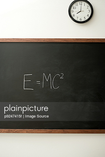 Blackboard and clock - p9247415f by Image Source